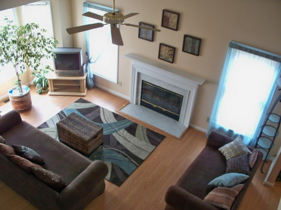 Family Room Has Bay Window and Fireplace